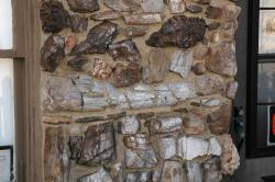 Fossil Cabin Museum wall: Fragments of 150 million year-old dinosaur bones make up the museum's exterior walls.