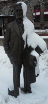 Snow job: The statue of F. Scott Fitzgerald had a healthy coating of snow today in our ongoing wintry spring.