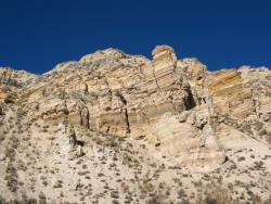 Green River Formation: Strata of the famed fossil-rich formation visible in Fossil Butte National Monument. The butte represents deposits from what was once the center of Fossil Lake that existed 50 million years ago during the Eocene Epoch in what is now western Wyoming.
