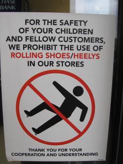 "Sign of the times: More stores, malls and public places are posting signs banning the use of ""heeling' shoes, shoes that have a wheel built into the heel to allow them to be used like a roller skate. (Photo by voteprime)"