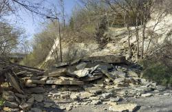 Debris from recent collapse of river bluff in St. Paul park: A massive shelf of Platteville limestone still hangs ready to come down.