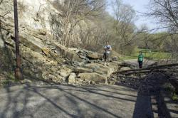 Hikers add scale to the rock slide