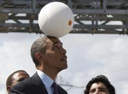 Using his head: On his recent trip to Africa, Presudent Obama tried out the new SOCCKET soccer ball.