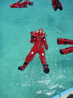 "floating in a ""gumby suit"": See how easy it is to float in a big, orange immersion suit?"
