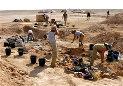 Archaeologists excavate mass graves in Iraq.