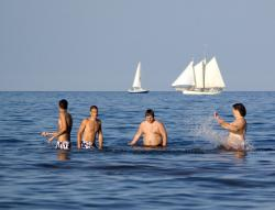 Beating the heat in Duluth, MN: Fearless swimmers take advantage of Lake Superior's record temps.
