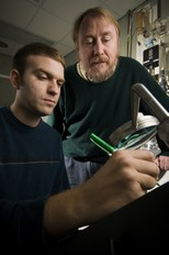 Richard Lenski (top) and Jeffrey Barrick view bacteria cultures in Lenski's lab.: They have watched the bacteria's DNA evolve over 40,000 generations.