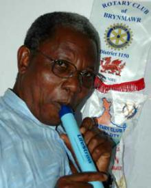 How it works: A Rotary Club member demonstrates the simple way a LifeStraw works. Put it in your mouth and simply suck up safe drinking water. The device can help prevent up to 6,000 deaths a day due to poor quality drinking water.
