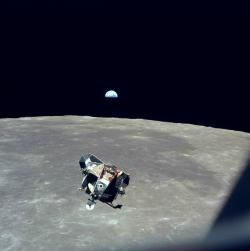 The LEM, the Earth, and the Moon: Astronaut Michael Collins captured this photograph of the lunar excursion module, the Moon, and the Earth from Columbia, the orbiting command module, during the historic Apollo 11 mission.