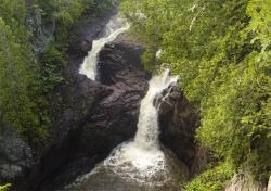 Devil's Kettle Falls: the east branch (right) drops 50 feet over the rocky cliff; the west branch (left) disappears into a cauldron.