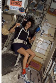 Fast in space: NASA astronaut Suni Williams ran a marathon Monday on a treadmill in the Intenrational Space Station concurrently with Earth-bound runners doing the Boston Marathon. Due to the weightless conditions in space, she had to be bungee-corded to the treadmill. (Photo courtesy of NASA)