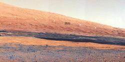 Martian unconformity at Mount Sharp: The line of white dots marks the contact point between the two disparate layers of rock.