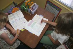 Two girls tackle their math together: Are they inadvertently taught to fear it?