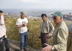 Charlie Matsch: the Minnesota geologist and professor emeritus (right) explains Duluth geology to GSA field trip participants in 2011.