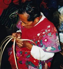 Making a hat: A Maya man starts the process of making a pishalal.
