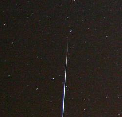 A meteor streaking across the night sky: The Geminid meteor shower peaks this week on the night of December 13-14.  Photo by Jeff Smallwood at flickr.com.