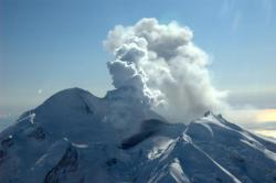 Newly erupted: This view of Mt. Redoubt is looking south as the volcano begins to erupt and send an ash cloud into the sky.