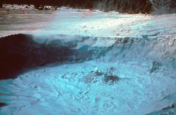 Yellowstone volcano of the past: A mud volcano in Norris Geyser Basin that was vigorously active in 1947, intermittently ejecting thick mud clots when surface water was scarce, but a surging gray viscous pool when surface water was more abundant, as shown here, when the pool was about 4