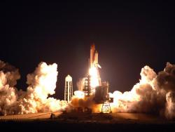 Spectacular night launch: The space shuttle Endeavor blasts off for a trip to the International Space Station.
