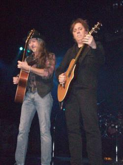 "Like minded: Doobie Brothers guitarists Pat Simmons (left) and John McFee get their fingers and minds in synch as they perform a guitar duet called ""Five Corners."""