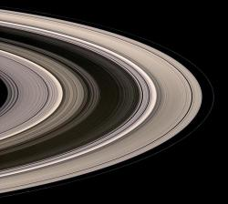 Saturn's rings: Saturn's icy rings shine in scattered sunlight in this view, which looks toward the unilluminated northern side of the rings from about 15 degrees above the ringplane.