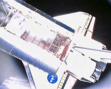 Image of Discovery: This image of Space Shuttle Discovery was taken by a miniature satellite that was released from Discovery's payload bay on Wednesday.  Image courtesy NASA TV.