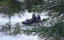 Snowmobiling: With the late appearance of winter, snowmobiles are finally zooming around. And some are going through the water as their drivers try to skip them over lakes and rivers.
