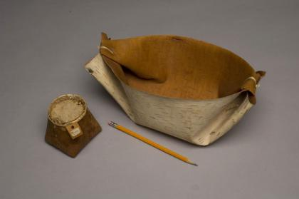 Folded and tied from a single piece of bark, buckets like this are seamless and leak-proof, making them excellent containers for collecting sap. The makuk stores sugar after it has been processed from the sap. Popular tourist items, this one originally sold for $1.00 in 1955.
