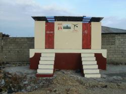Dry composting toilets similar to this one will provide sanitary fertilizer and gas for cooking food when used with a biogas digester.