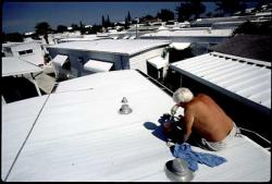 White roofs reflect heat, leaving the structures below cooler: Photo by gadfly pro from Flickr.com