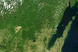 Tornado trail seen from space: Tens of thousands of trees were leveled June 7, 2007 in Wisconsin.